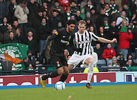 Lassad Nouioui being closely marked by Marc McAusland in the St Mirren v Celtic Scottish Communities League Cup Semi Final match played at Hampden Park, Glasgow on 27.1.13.