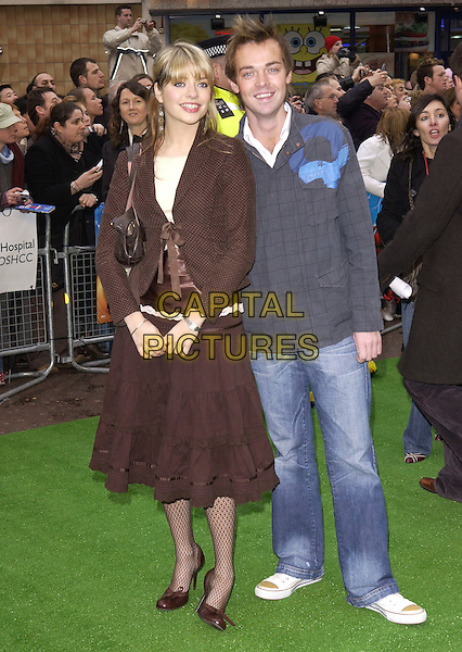 """HOLLY WILLOUGHBY & STEPHEN MULTHERN.arrivals at premiere of.""""The Magic Roundabout"""".vue cinema, Leicester Square.London 30 January 2005.full length brown jacket skirt steven.Ref: DH.www.capitalpictures.com.sales@capitalpictures.com.©Capital Pictures."""