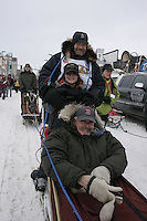 Jim Lanier and his son Jimmy and Iditarider Charles Dumbaugh in Anchorage on Saturday March 1st during the ceremonial start day of the 2008 Iidtarod Sled Dog Race.