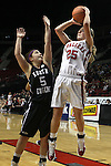 03/11/11--Clackamas' Shelby Vasconcellos-Mattocks shoots over South Eugene's Olivia Roberts in the semifinals of the 6A girls state championship at the Rose Garden in Portland, Or. The Cavaliers advanced to the championship with a score of 46-35...Photo by Jaime Valdez..............................................