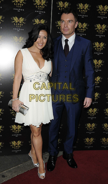 Hayley Tamaddon &amp; Greg Burns<br /> The Lipsy VIP Fashion Awards 2013, DSTRKT, Rupert St., London, England.<br /> May 29th, 2013<br /> full length blue suit white dress <br /> CAP/CAN<br /> &copy;Can Nguyen/Capital Pictures