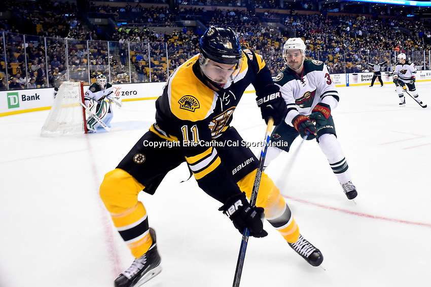Thursday, November 19, 2015: Minnesota Wild defenseman Nate Prosser (39) tries to stick check Boston Bruins right wing Jimmy Hayes (11) at the boards during the National Hockey League game between the Minnesota Wild and the Boston Bruins held at TD Garden, in Boston, Massachusetts. The Bruins defeat the Wild 4-2. Eric Canha/CSM