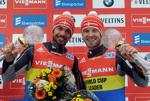 20.02.2016. Winterberg, Germany.  Tobias Wendl (L-R) and Tobias Arlt of Germany celebrate after winning the overall 2015/2016 season during the victory ceremony following the men's two-seater event at the Luge World Cup in Winterberg, Germany, 20 February 2016.