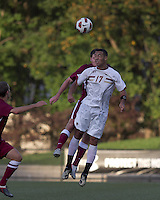 Harvard University defender Eric Slingerland (26) and Boston College forward Charlie Rugg (17) battle for head ball. Boston College defeated Harvard University, 2-0, at Newton Campus Field, October 11, 2011.