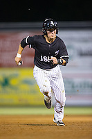 Bradley Strong (18) of the Kannapolis Intimidators hustles towards third base against the Greenville Drive at Intimidators Stadium on June 7, 2016 in Kannapolis, North Carolina.  The Drive defeated the Intimidators 5-2 in game two of a double header.  (Brian Westerholt/Four Seam Images)