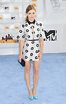 LOS ANGELES, CA - APRIL 12: Singer Holland Roden arrives at the 2015 MTV Movie Awards at Nokia Theatre L.A. Live on April 12, 2015 in Los Angeles, California.