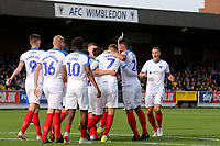 Portsmouth players congratulate Tom Naylor after scoring their opening goal during AFC Wimbledon vs Portsmouth, Sky Bet EFL League 1 Football at the Cherry Red Records Stadium on 13th October 2018