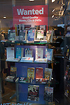 Charity shop window display of books