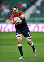 Tom Wood of England catches the ball during the pre-match warm-up. QBE International match between England and France on August 15, 2015 at Twickenham Stadium in London, England. Photo by: Patrick Khachfe / Onside Images