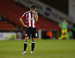 Stefan Scougall of Sheffield Utd is taken ill during the game during the League One match at Bramall Lane Stadium, Sheffield. Picture date: September 27th, 2016. Pic Simon Bellis/Sportimage