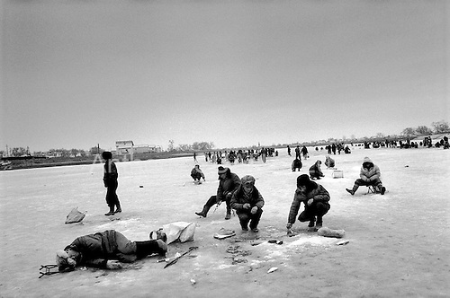 Atyrau, Kazakhstan .1998.Thousands of fishermen fish the frozen over Ural River which runs through the oil rich capital of Atyrau. Most of the factories in the region are closed and fishing is a mater of survival as residents claim that unemployment is at 90%..