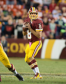 Washington Redskins quarterback Kirk Cousins (8) looks to pass in the third quarter of the game against the Seattle Seahawks at FedEx Field in Landover, Maryland on Monday, October 6, 2014.  The Seahawks won the game 27 - 17.<br /> Credit: Ron Sachs / CNP