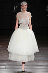 Model walks runway in a Cannes bridal gown from the Naeem Khan Bridal Spring 2017 collection at 260 West 36 Street, during New York Bridal Fashion Week Spring Summer 2017 on April 16, 2016.