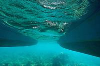 Catamaran's hull and coral reef underwater, Saona Island, Dominican Republic