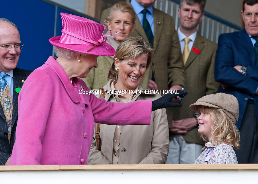 """THE QUEEN, LADY LOUISE WINDSOR and SOPHIE, Countess of Wessex..The Queen shares an intimate moment for all to see as she plays with the hat of her Grandchild, Lady Louise Windsor and puts a beaming smile across her face..The Royal Windsor Horse Show 2011, Windsor_14/05/2011.Mandatory Photo Credit: ©Dias/Newspix International..**ALL FEES PAYABLE TO: """"NEWSPIX INTERNATIONAL""""**..PHOTO CREDIT MANDATORY!!: NEWSPIX INTERNATIONAL(Failure to credit will incur a surcharge of 100% of reproduction fees)..IMMEDIATE CONFIRMATION OF USAGE REQUIRED:.Newspix International, 31 Chinnery Hill, Bishop's Stortford, ENGLAND CM23 3PS.Tel:+441279 324672  ; Fax: +441279656877.Mobile:  0777568 1153.e-mail: info@newspixinternational.co.uk"""