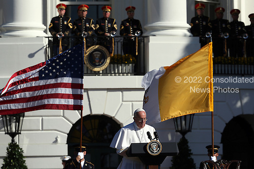 Pope Francis speaks with U.S. President Barack Obama during the arrival ceremony at the White House on September 23, 2015 in Washington, DC. The Pope begins his first trip to the United States at the White House followed by a visit to St. Matthew's Cathedral, and will then hold a Mass on the grounds of the Basilica of the National Shrine of the Immaculate Conception. <br /> Credit: Win McNamee / Pool via CNP