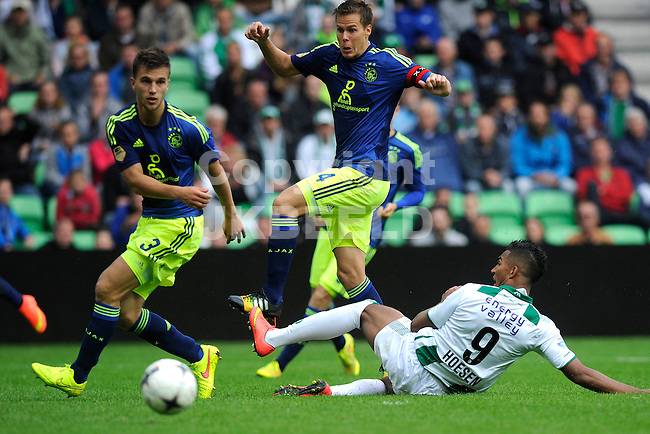 GRONINGEN - Voetbal, FC Groningen - Ajax,  Eredivisie, Euroborg, seizoen 2014-2015, 31-08-2014,   FC Groningen speler Danny Hoesen  met  Ajax speler Niklas Moislander