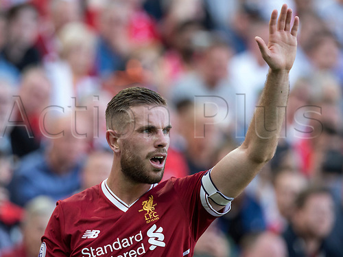 27th August 2017, Anfield, Liverpool, England; EPL Premier League football, Liverpool versus Arsenal; Captain Jordan Henderson of Liverpool signals to his team mates before taking a corner kick at the Kop end