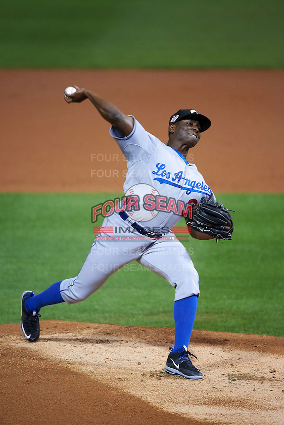 Glendale Desert Dogs pitcher Jharel Cotton (37) delivers a pitch during an Arizona Fall League game against the Salt River Rafters on October 22, 2015 at Salt River Fields at Talking Stick in Scottsdale, Arizona.  Glendale defeated Salt River 7-5.  (Mike Janes/Four Seam Images)