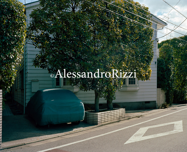 A car parked next to a House