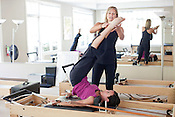 June 3, 2011. Durham, NC.. Pilates instructor Mischa Abshire, directs a class in an equipment based pilates workout at InsideOut Body Therapies..