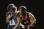 Pictures of rock band AC-DC performing in concert during the 1980's