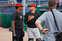 Batavia Muckdogs Dalvy Rosario (left) and Igor Baez (right) conduct an interview with The Batavian during practice on June 12, 2019 at Dwyer Stadium in Batavia, New York.  (Mike Janes/Four Seam Images)
