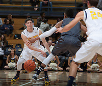 Sam Singer of California passes the ball during the game against UC Irvine at Haas Pavilion in Berkeley, California on December 2nd, 2013.  California defeated UC Irvine, 73-56.