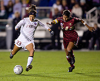 Christen Press (23) of Stanford takes a shot past Chelsea Regan (2) of Boston College during the second game of the NCAA Women's College Cup at WakeMed Soccer Park in Cary, NC.  Stanford defeated Boston College, 2-0.