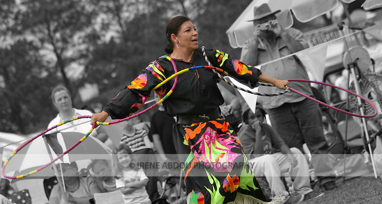 Virginia Beach, Virginia: April 26, 2008.  A Native American hoop dancer, flapping the hoops like eagle wings, performs at the 8th Annual Red Wing PowWow in Red Wing Park, Virginia Beach, Virginia.