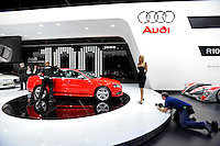 A model poses beside the Audi S4 at the Detroit Auto Show in Detroit, Michigan on January 12, 2009.
