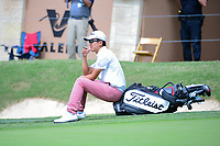 Michael Kim (USA) sits on his bag after putting on 18 during round 1 of the Valero Texas Open, AT&amp;T Oaks Course, TPC San Antonio, San Antonio, Texas, USA. 4/20/2017.<br /> Picture: Golffile | Ken Murray<br /> <br /> <br /> All photo usage must carry mandatory copyright credit (&copy; Golffile | Ken Murray)