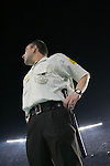 A security guard watches the crowd as the crowd become restless after the referee sends off a Barca player. Barcelona v Osasuna (0-1), La Liga, Nou Camp, Barcelona, 23rd May 2009.