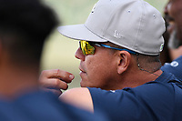 Manager Pedro Lopez (32) of the Columbia Fireflies watches batting practice from behind the cage before a game against the Greenville Drive on Wednesday, April 18, 2018, at Fluor Field at the West End in Greenville, South Carolina. Columbia won 8-4. (Tom Priddy/Four Seam Images)