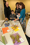 Museum Curator of Education Deborah Stevenson, right, talks about native fauna with the Philibert family during Nevada Wildflower Family Fun Day at the Nevada State Museum in Carson City Saturday April 11, 2015. Visitors such as Jason, left, Nicolau and Teresa were treated to lots of information, hands-on experiences and crafts.<br />