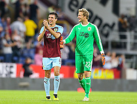 Burnley's man of the match Jack Cork applauds the fans with Anders Lindegaard<br /> <br /> Photographer Alex Dodd/CameraSport<br /> <br /> UEFA Europa League - Europa League Qualifying Round 2 2nd Leg - Burnley v Aberdeen - Thursday 2nd August 2018 - Turf Moor - Burnley<br />  <br /> World Copyright © 2018 CameraSport. All rights reserved. 43 Linden Ave. Countesthorpe. Leicester. England. LE8 5PG - Tel: +44 (0) 116 277 4147 - admin@camerasport.com - www.camerasport.com