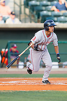 Tzu-Wei Lin (36) of the Greenville Drive starts down the first base line against the Charleston RiverDogs at Joseph P. Riley, Jr. Park on May 26, 2014 in Charleston, South Carolina.  The Drive defeated the RiverDogs 11-3.  (Brian Westerholt/Four Seam Images)