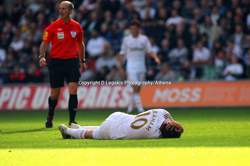 Saturday, 06 October 2012<br /> Pictured: Danny Graham of Swansea injured on the ground<br /> Re: Barclays Premier League, Swansea City FC v Reading at the Liberty Stadium, south Wales.