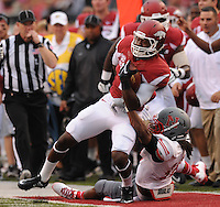 NWA Media/ANDY SHUPE - Arkansas Damon Mitchell, center, carries the ball as Nicholls defensive back Toren Joseph defends during the fourth quarter Saturday, Sept. 6, 2014, at Razorback Stadium in Fayetteville