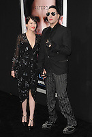 Marilyn Manson &amp; Lindsay Usich at the Los Angeles premiere of &quot;Transcendence&quot; at the Regency Village Theatre, Westwood.<br /> April 10, 2014  Los Angeles, CA<br /> Picture: Paul Smith / Featureflash