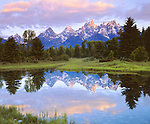 USA; Wyoming, Grand Teton National Park.   Grand Tetons reflecting in the Snake River
