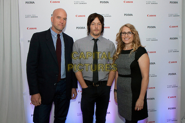 Aaron Warkov, Norman Reedus &amp; Robin Riley<br /> at the Canon USA Pixma Pro City Senses Gallery in New York City, NY, USA.<br /> September 26th, 2013 <br /> half length grey gray shirt black tie goatee facial hair dress suit blue glasses <br /> CAP/MPC/LT<br /> &copy;Laura Trevino/ MediaPunch/Capital Pictures
