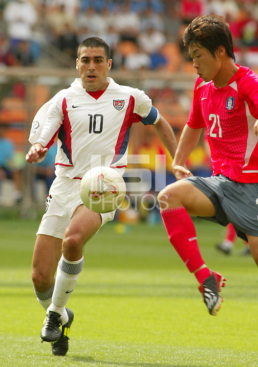 Claudio Reyna goes for a ball. The USA tied South Korea, 1-1, during the FIFA World Cup 2002 in Daegu, Korea.