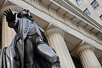 Federal Hall National Memorial, designed by John Frazee in Neoclassical style and built 1842 as the United States Custom House, and the bronze statue of George Washington, 1882, by John Quincy Adams Ward, on Wall St, Manhattan, New York, New York, USA. The building replaces the original Federal Hall, demolished in 1812, which was built in 1700 as New York's City Hall, and was the first capitol building of the USA under the Constitution, site of George Washington's inauguration and the US Bill of Rights in the First Congress. The building is now run by the National Parks of New York Harbor. Picture by Manuel Cohen