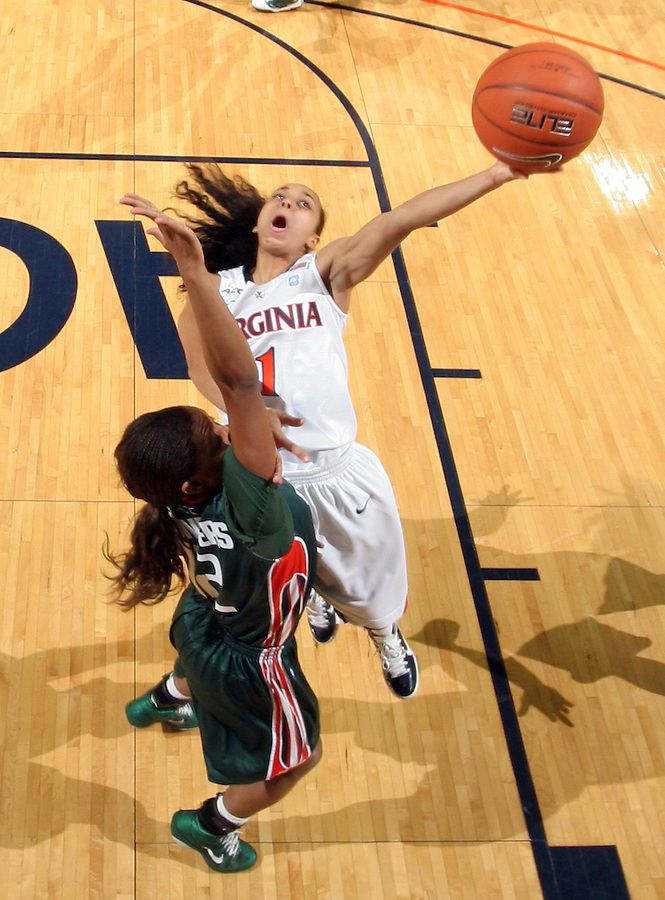 Jan. 6, 2011; Charlottesville, VA, USA; Virginia Cavaliers guard China Crosby (1) shoots over Miami Hurricanes guard Krystal Saunders (12) during the game at the John Paul Jones Arena. Miami won 82-73. Mandatory Credit: Andrew Shurtleff
