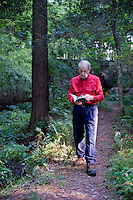 Allen DeHArt identifies native wildflowers as we hike the  trails at DeHart Botanical Gardens in Louisburg, NC.