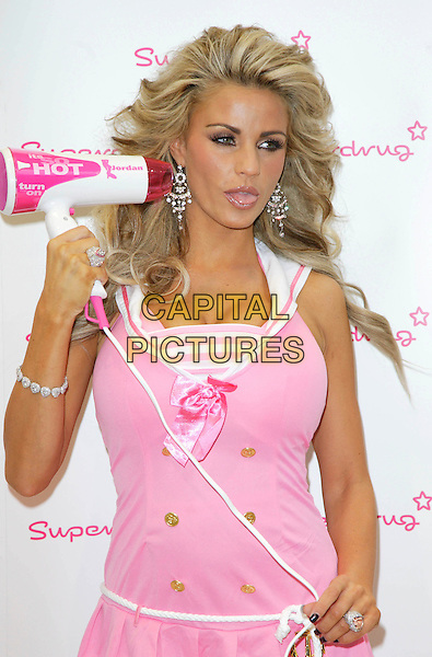 JORDAN - KATIE PRICE .Launches Jordan Haircare Electricals at Superdrug, Kensington High Street, London, England..October 25th 2007.half length pink dress top hairdryer diamond ring bracelets earrings mouth open tongue funny face .CAP/ROS.©Steve Ross/Capital Pictures