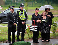Pictured: Locals, members of the emergency services attend the burial of baby Sion at Thornhill Cemetery, Cardiff, Wales, UK. Tuesday 28 June 2016<br /> Re: The funeral of Sion, the baby boy found dead in the River Taff in Cardiff has taken place<br /> Generous locals raised nearly &pound;1,400 for the memorial after reading about plans to hold a fitting ceremony for the newborn baby whose body was discovered in Cardiff a year ago.<br /> The funeral took place at the Briwnant Chapel at Thornhill Crematorium, Cardiff. Members of the public are invited to be among the congregation.