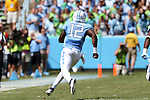 19 September 2015: UNC's Marquise Williams runs up the sideline. The University of North Carolina Tar Heels hosted the University of Illinois Fighting Illini at Kenan Memorial Stadium in Chapel Hill, North Carolina in a 2015 NCAA Division I College Football game. UNC won the game 48-14.