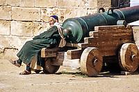 Essaouira, Morocco - Moroccan Man and Portuguese Cannon.